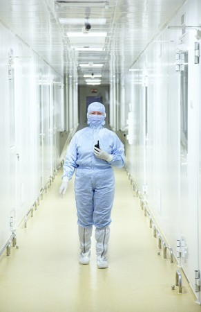 Biology reseach center. People in protective wear  Stock Photo - 8105442