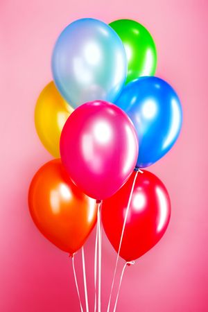 colored balloons isolated on the pink background photo