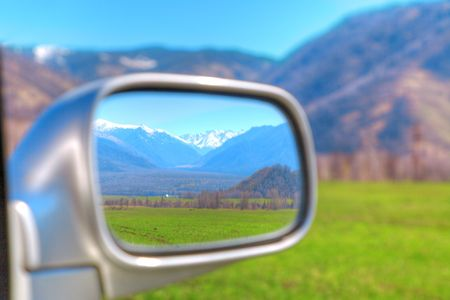 beautiful rural landscape in the rear-view mirror photo