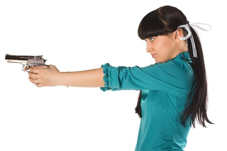 Young woman with hand gun isolated on white Stock Photo - 8206831