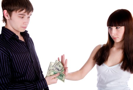 young woman rejecting man's offer Stock Photo - 8206935