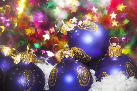 Blue christmas baubles with blured lights in background photo