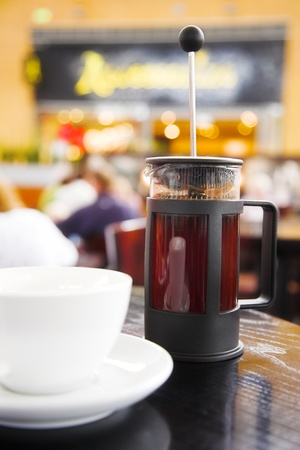 French coffee press with freshly brewed coffee  photo