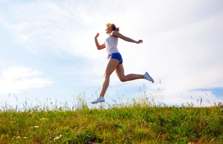 young happy girl running on sunny meadow Stok Fotoğraf
