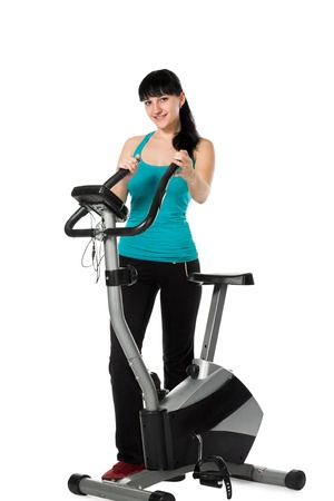 static bike: beauty woman working out with stationary bicycle
