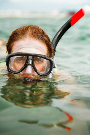 young beauty woman swimming in diving mask photo