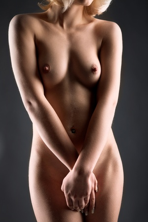nude breast: shy nude girl isolated on gray background