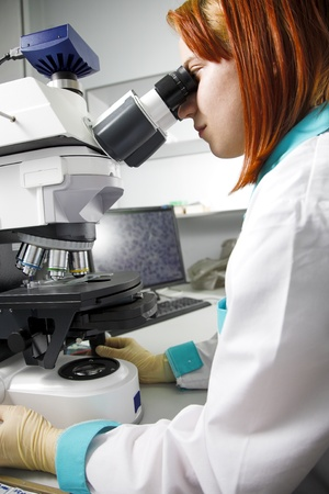 young woman with microscope in research center Stock Photo - 8696860