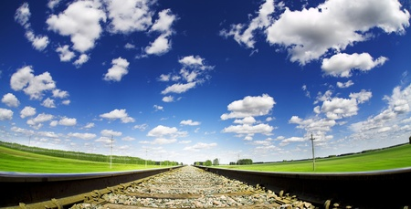 summe landscape with railroad and cloudy sky photo