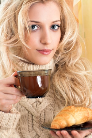 beauty girl with cup in her hand photo