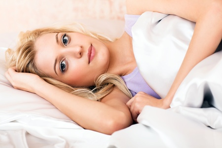 young beauty girl lying in the bed Stock Photo - 8773104