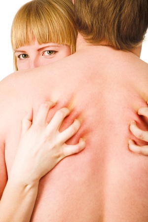 Woman scratching man back isolated on white Stock Photo - 8886541