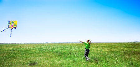 young girl with kite in sumer field photo