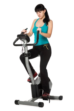stationary bike: beauty woman working out with stationary bicycle