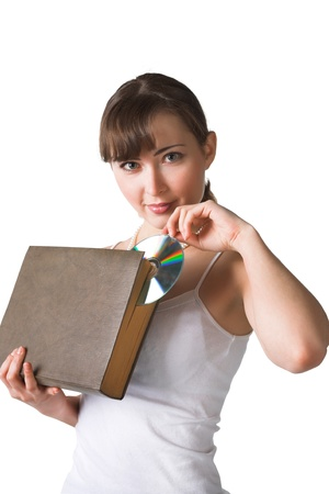 woman holding big book and compact disk  photo