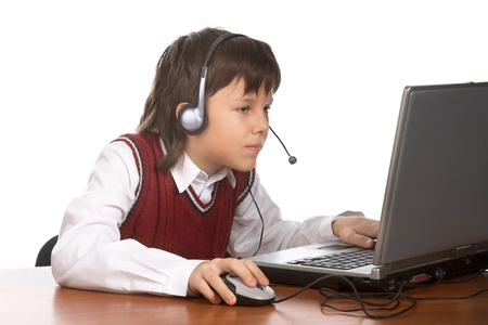 young boy in headset playing with laptop Stock Photo - 8987998
