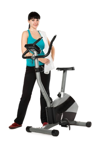 beauty woman working out with stationary bicycle  photo