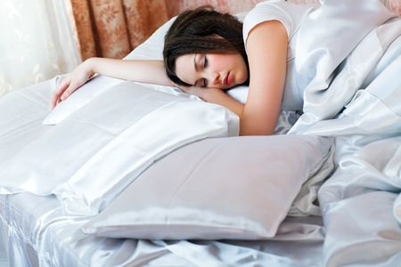 young beauty girl sleeping in the bed photo