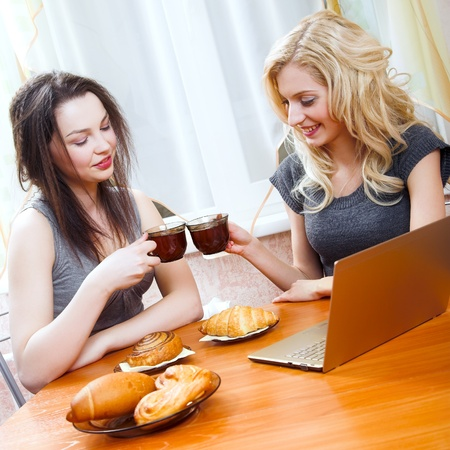 young beauty girls sitting at the table photo