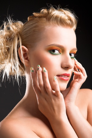 beauty woman with brightly makeup isolated on black photo