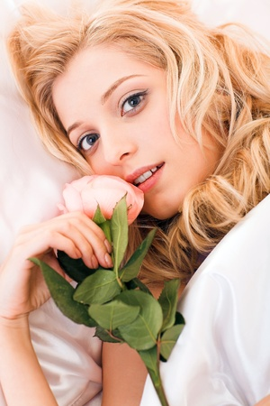 young beauty girl lying in the bed photo