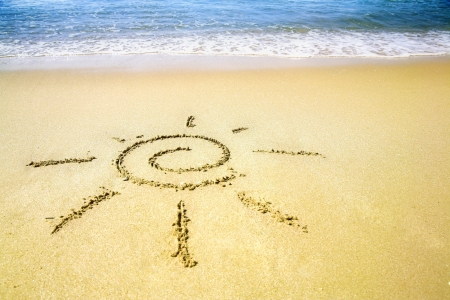 Sun pictured on the summer sandy beach Stock Photo