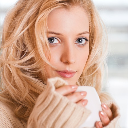beauty girl with cup in her hand Stock Photo - 9306648