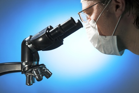 medical scientist: Closeup of a male researcher looking through microscope