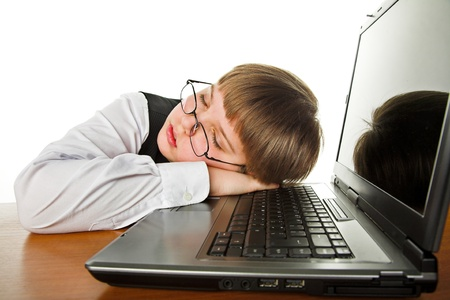 tired young boy sleeping on the laptop Stock Photo - 9497412
