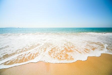 sunny beach, blue ocean and clean sky photo