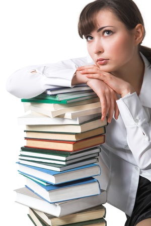 student sitting near the pile of books photo