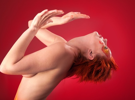 nudes: portrait of beautiful woman with a make-up on a red background