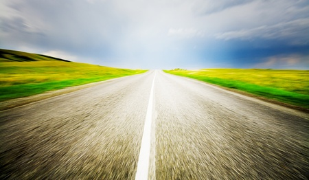 way to freedom: High speed road with cloudy sky background  Stock Photo