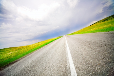 High speed road with cloudy sky background Stock Photo