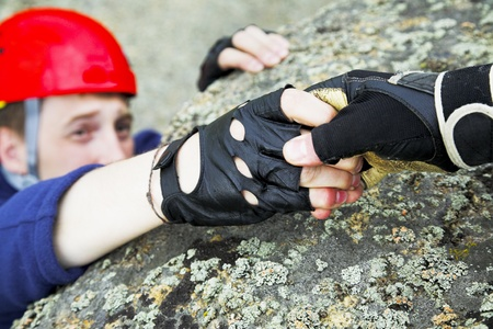 catches: climber reach out for help. focus on hands