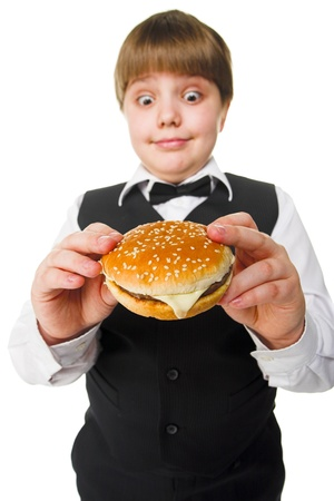 diner: fun young fat schoolboy eating big hamburger