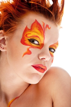 portrait of beautiful girl with fire bodyart photo