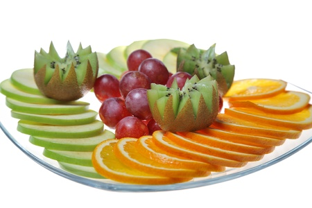 snack with fruits and grapes on plate photo