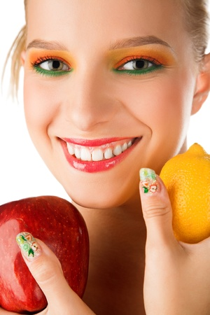 beauty woman with apple and lemon in hand photo