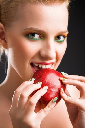 beauty woman with red apple in the hand photo