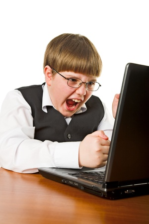 aggressive boy with laptop isolated on white photo