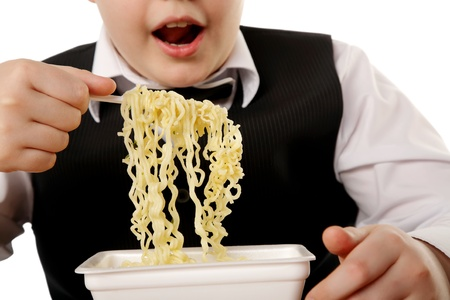 boy eating chinese instant noodles isolated on white 스톡 콘텐츠