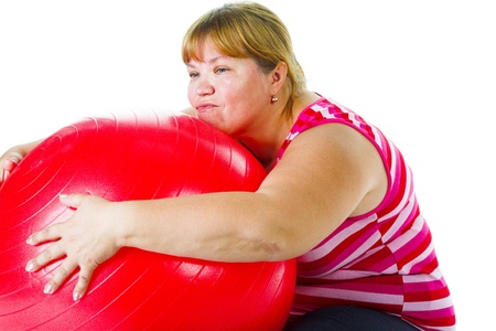Tired fat woman with big red gymnastic ball photo
