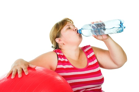 Tired fat woman with big red gimnastic Stock Photo - 10042981