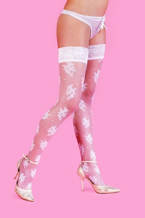 Beautiful woman legs isolated on pink background photo
