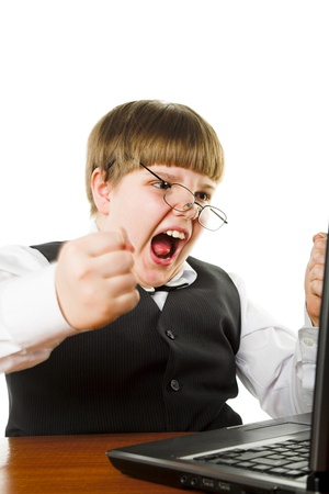 aggressive boy with laptop isolated on white