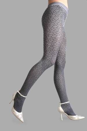 Beautiful woman legs isolated on gray background photo