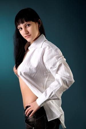 Portrait of beautiful woman on a blue cyan background photo