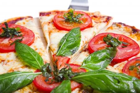 margherita: pizza margarita isolated on the white background