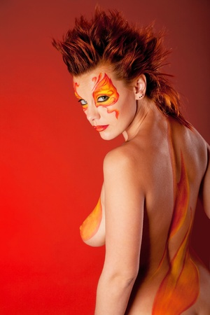 bodyart: portrait of beautiful woman with a make-up on a red background